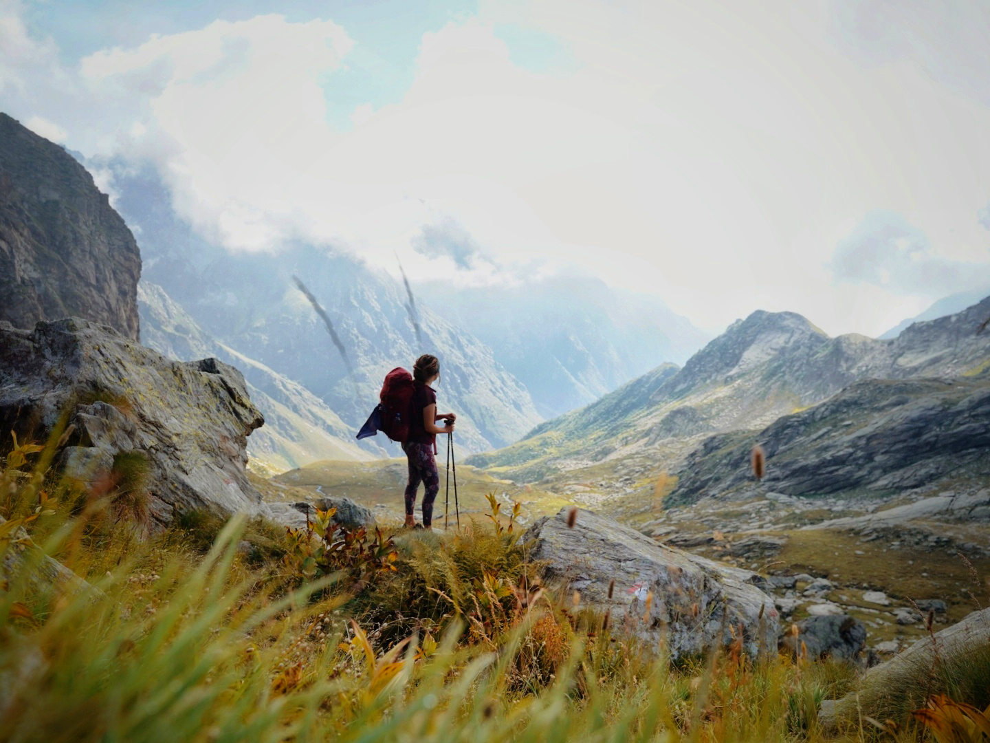A solo backpacker crossing an alpine pass