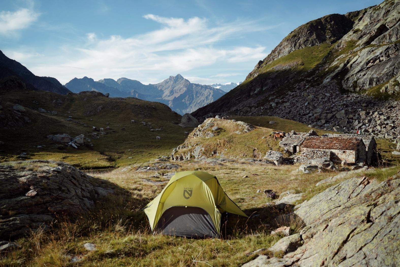 A tent in the alpine landscape of the Grande Traversata delle Alpi